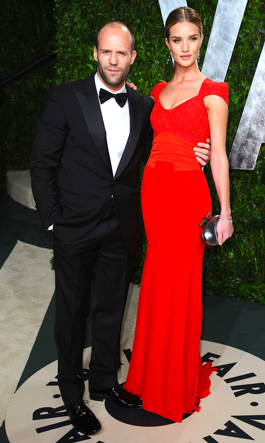 WEST HOLLYWOOD, CA - FEBRUARY 26: Actor Jason Statham (L) and actress Rosie Huntington-Whiteley arrives at the 2012 Vanity Fair Oscar Party hosted by Graydon Carter at Sunset Tower on February 26, 2012 in West Hollywood, California. (Photo by Alberto E. Rodriguez/Getty Images)
