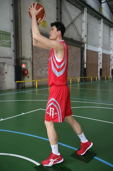 Яо Мин (34), китайский баскетболист