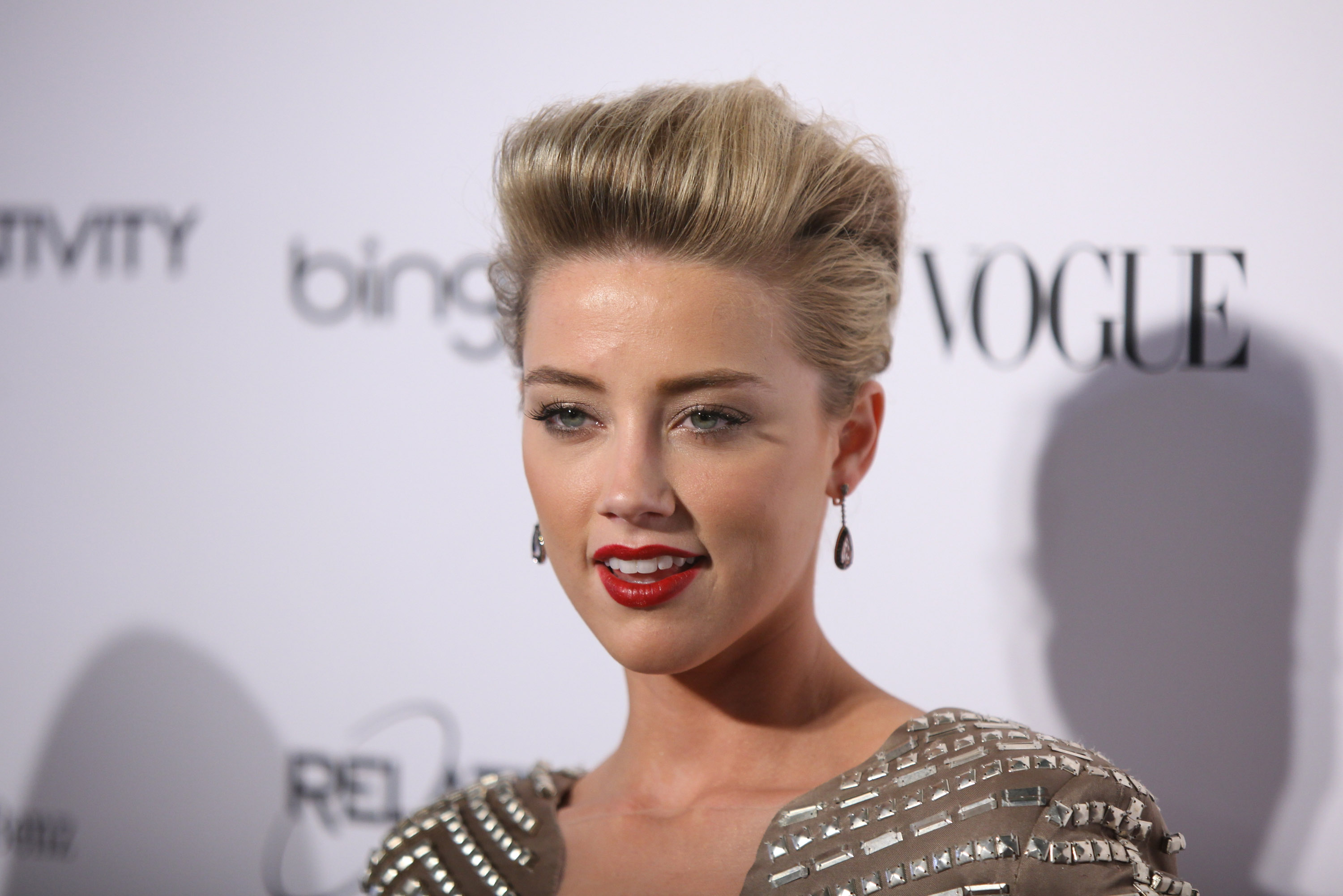 "LOS ANGELES, CA - JANUARY 15:  Actress Amber Heard attends the Art Of Elysium ""Heaven"" Gala 2011 at The California Science Center Exposition Park on January 15, 2011 in Los Angeles, California.  (Photo by Neilson Barnard/Getty Images)"