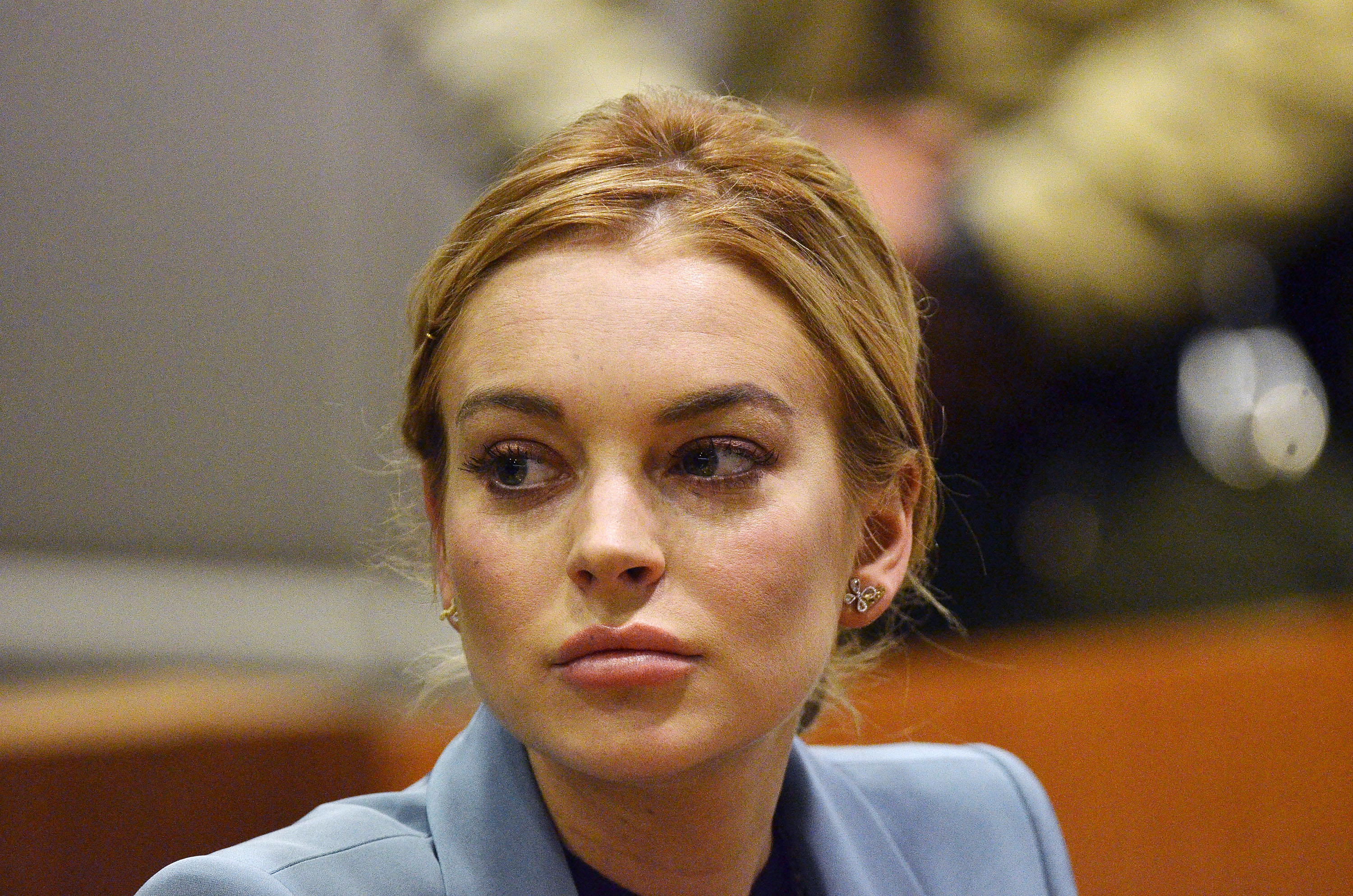 LOS ANGELES, CA - MARCH 29:  Lindsay Lohan attends her probation hearing with attorney Shawn Chapman Holley (not pictured) at the Airport Courthouse on March 29, 2012 in Los Angeles, California. Judge Stephanie Sautner ended Lohan's formal probation after concluding that she has completed the terms of her sentence for her 2007 DUI conviction and probation violations.  Lohan is now on informal probation until May 2014 for her 2011 Venice, California jewelry theft conviction.  (Photo Joe Klamer-Pool/Getty Images)
