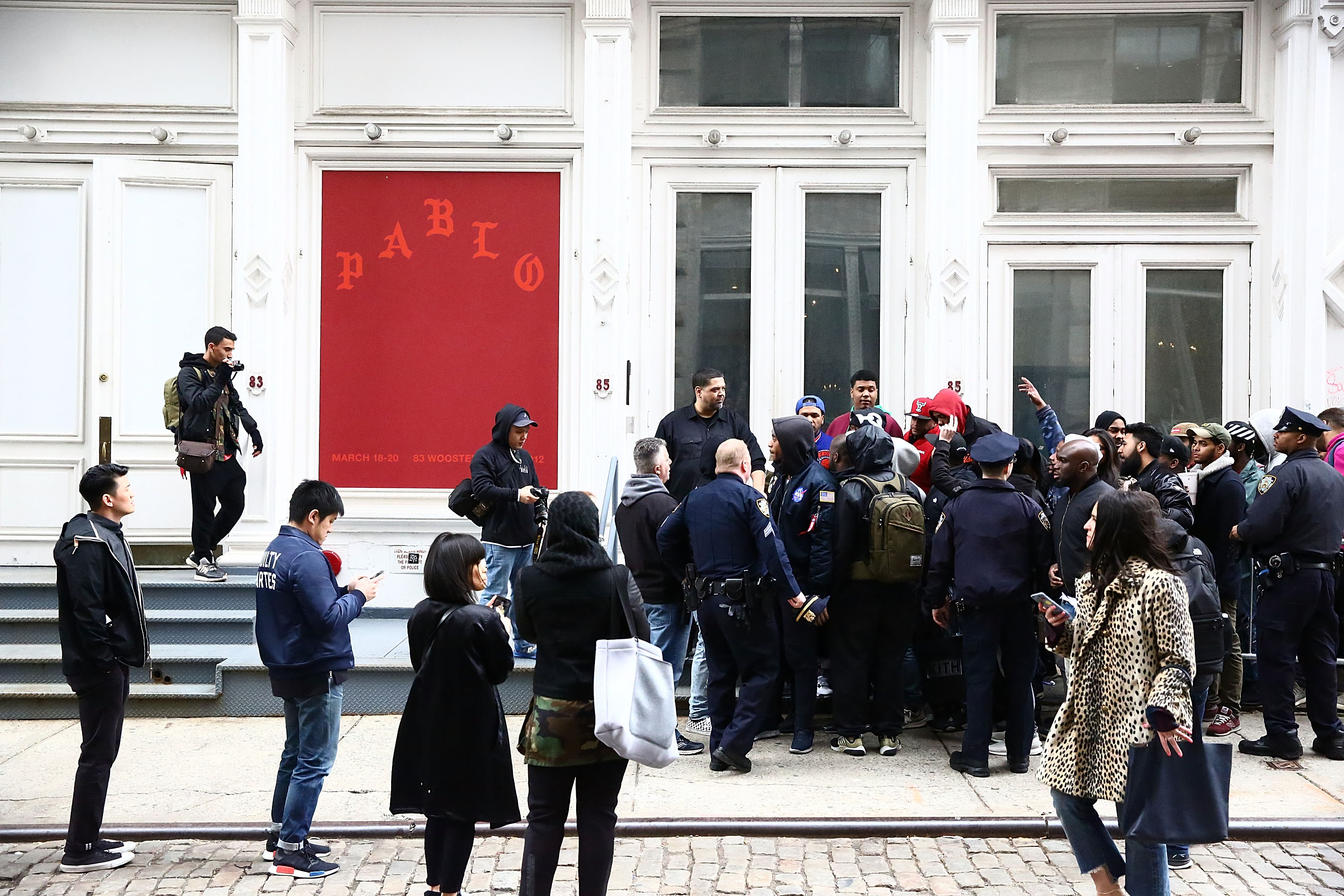 """NEW YORK, NY - MARCH 18:  NYPD guard the area near 83 Wooster Street in Soho at the Kanye West """"Pablo Pop-Up Shop"""" In Manhattan on March 18, 2016 in New York City.  (Photo by Astrid Stawiarz/Getty Images)"""