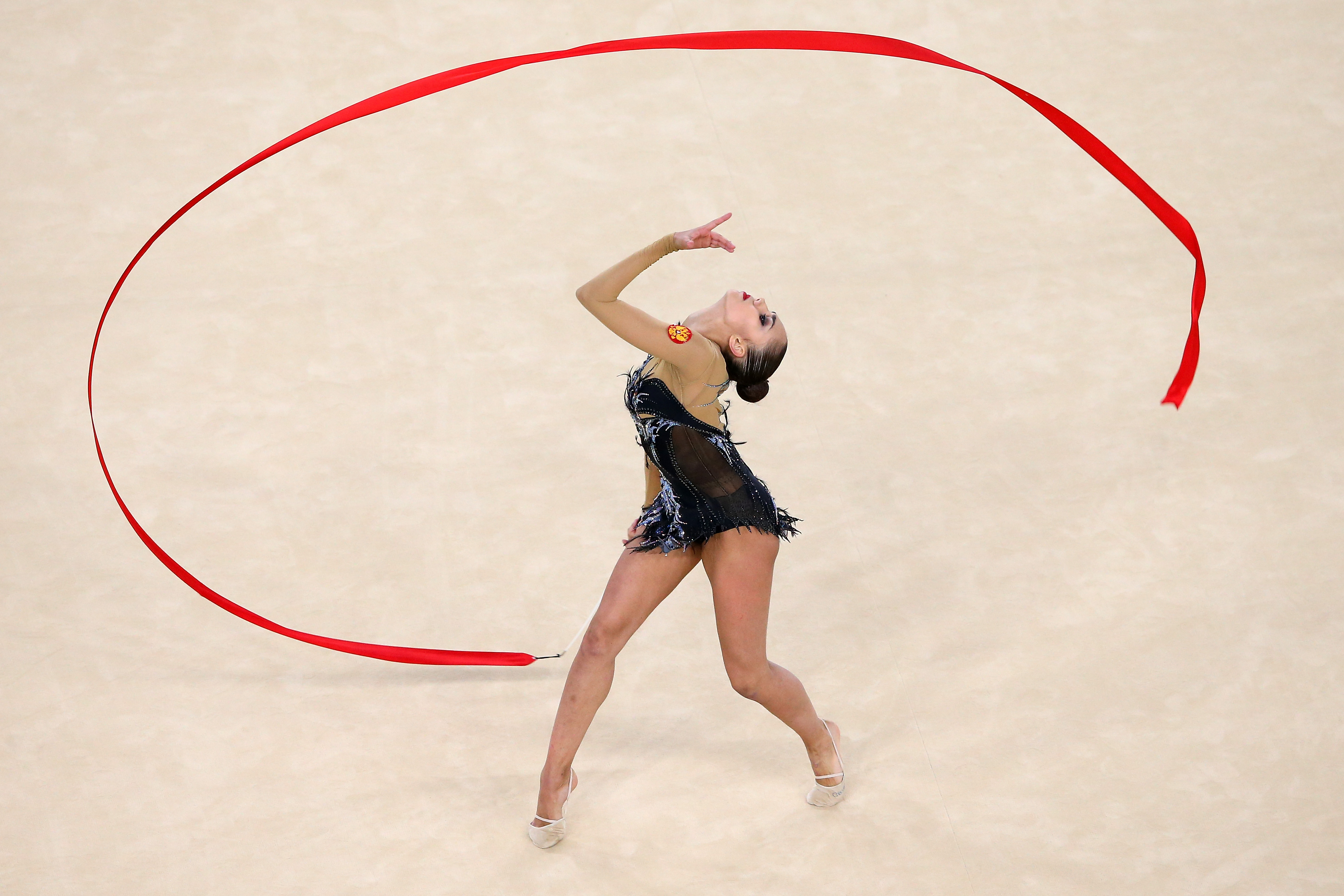 RIO DE JANEIRO, BRAZIL - AUGUST 20: Margarita Mamun of Russia competes during the Women's Individual All-Around Rhythmic Gymnastics Final on Day 15 of the Rio 2016 Olympic Games at the Rio Olympic Arena on August 20, 2016 in Rio de Janeiro, Brazil. (Photo by Alex Livesey/Getty Images)