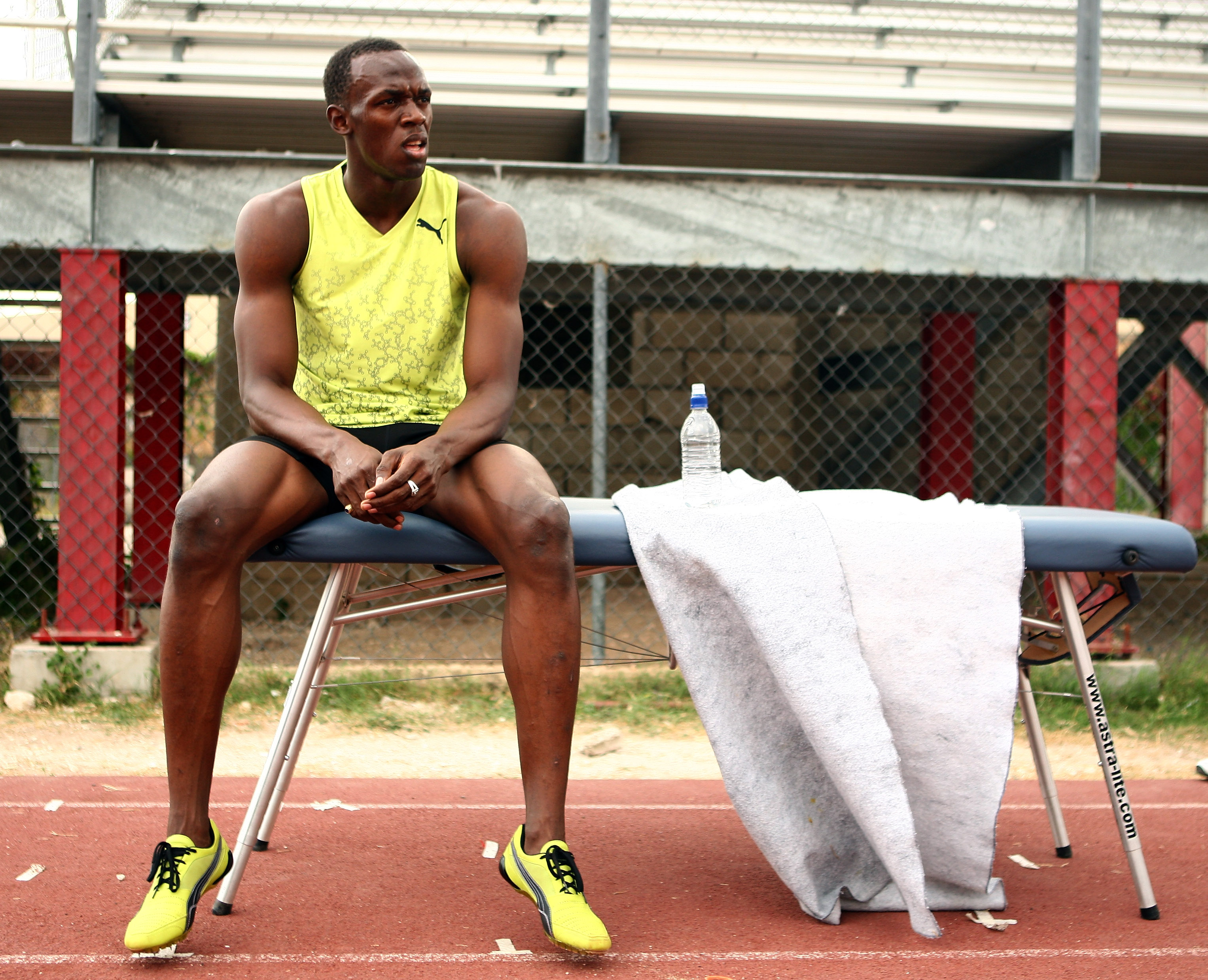 KINGSTON, JAMAICA - APRIL 06: Usain Bolt of Jamaica sits on a massage table following a training session at the National Stadium on April 6, 2009 in Kingston, Jamaica. (Photo by Ian Walton/Getty Images)