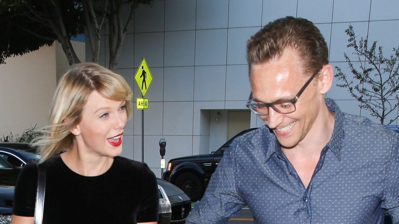 *EXCLUSIVE* Santa Monica, CA - Taylor Swift and Tom Hiddleston arrive hand in hand with ear to ear smiles for a romantic dinner for two at Hillstone in Santa Monica. The happy couple smiled for cameras on their way out with their bodyguards after dinner. Taylor wore a black crop top with a matching skirt and gold sandals as she held tight to Tom's hand. AKM-GSI   July  27, 2016 To License These Photos, Please Contact : Maria Buda (917) 242-1505 mbuda@akmgsi.com sales@akmgsi.com or  Mark Satter (317) 691-9592 msatter@akmgsi.com sales@akmgsi.com www.akmgsi.com