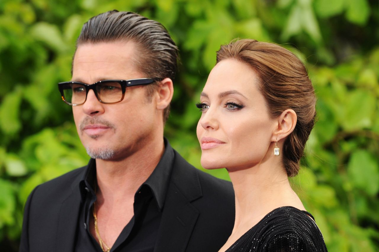 LONDON, ENGLAND - MAY 08:  Brad Pitt and Angelina Jolie attend the 'Maleficent' Costume And Props Private Reception at Kensington Palace on May 8, 2014 in London, England.  (Photo by Dave J Hogan/Getty Images)