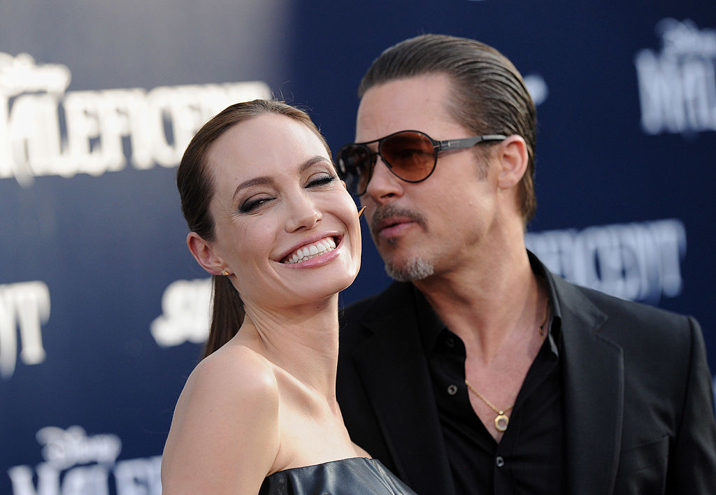 HOLLYWOOD, CA - MAY 28:  Actors Angelina Jolie and Brad Pitt arrive at the World Premiere of Disney's 'Maleficent' at the El Capitan Theatre on May 28, 2014 in Hollywood, California.  (Photo by Axelle/Bauer-Griffin/FilmMagic)