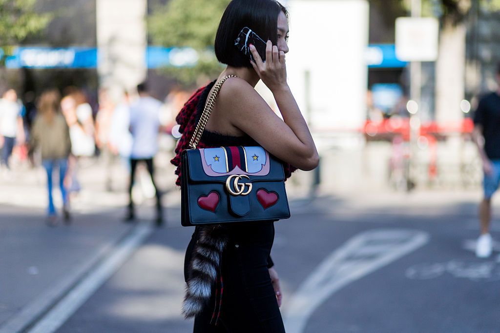 MILAN, ITALY - SEPTEMBER 24: Tiffany Hsu wearing a Gucci bag outside Jil Sander during Milan Fashion Week Spring/Summer 2017 on September 24, 2016 in Milan, Italy. (Photo by Christian Vierig/Getty Images)