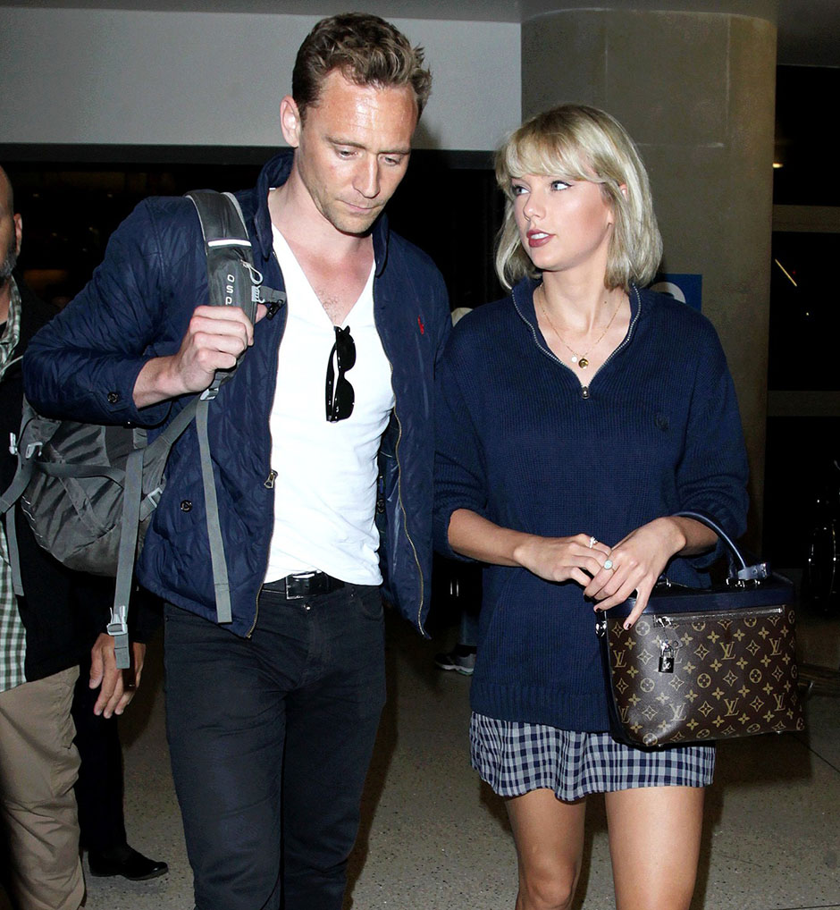 NO JUST JARED USAGE Taylor Swift and Tom Hiddleston arriving at the Los Angeles International Airport  Pictured: Taylor Swift, Tom Hiddleston