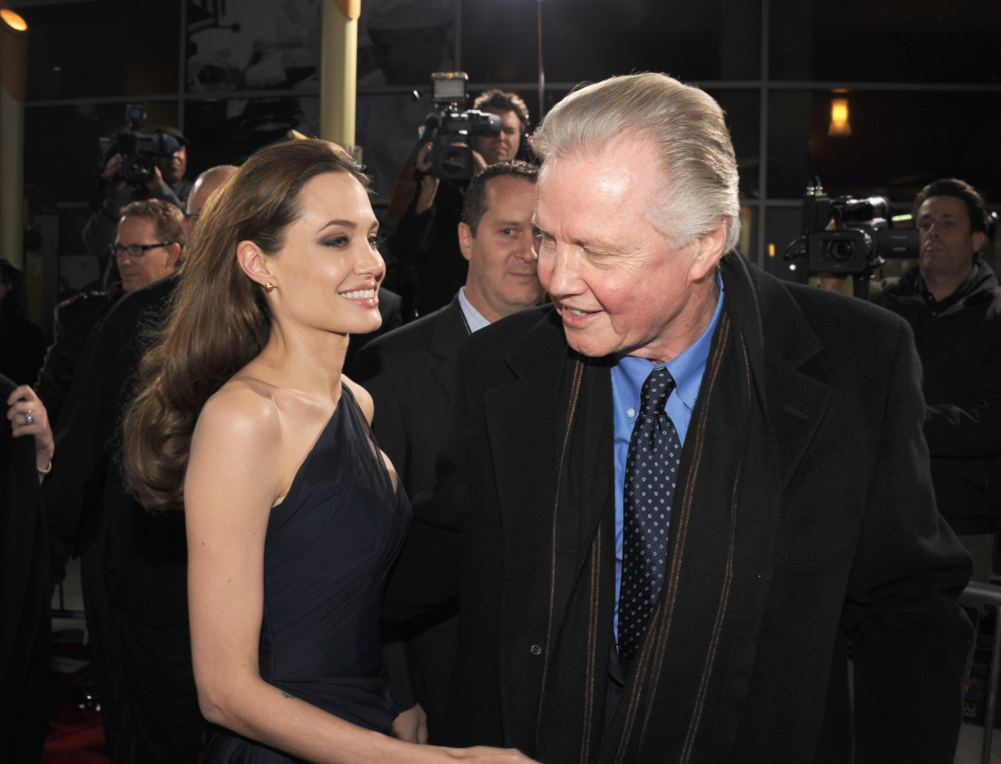 "HOLLYWOOD, CA - DECEMBER 08: Writer/director Angelina Jolie (L) and actorJon Voight arrive at the premiere of FilmDistrict's ""In the Land of Blood and Honey"" held at ArcLight Cinemas on December 8, 2011 in Hollywood, California. (Photo by Kevin Winter/Getty Images)"