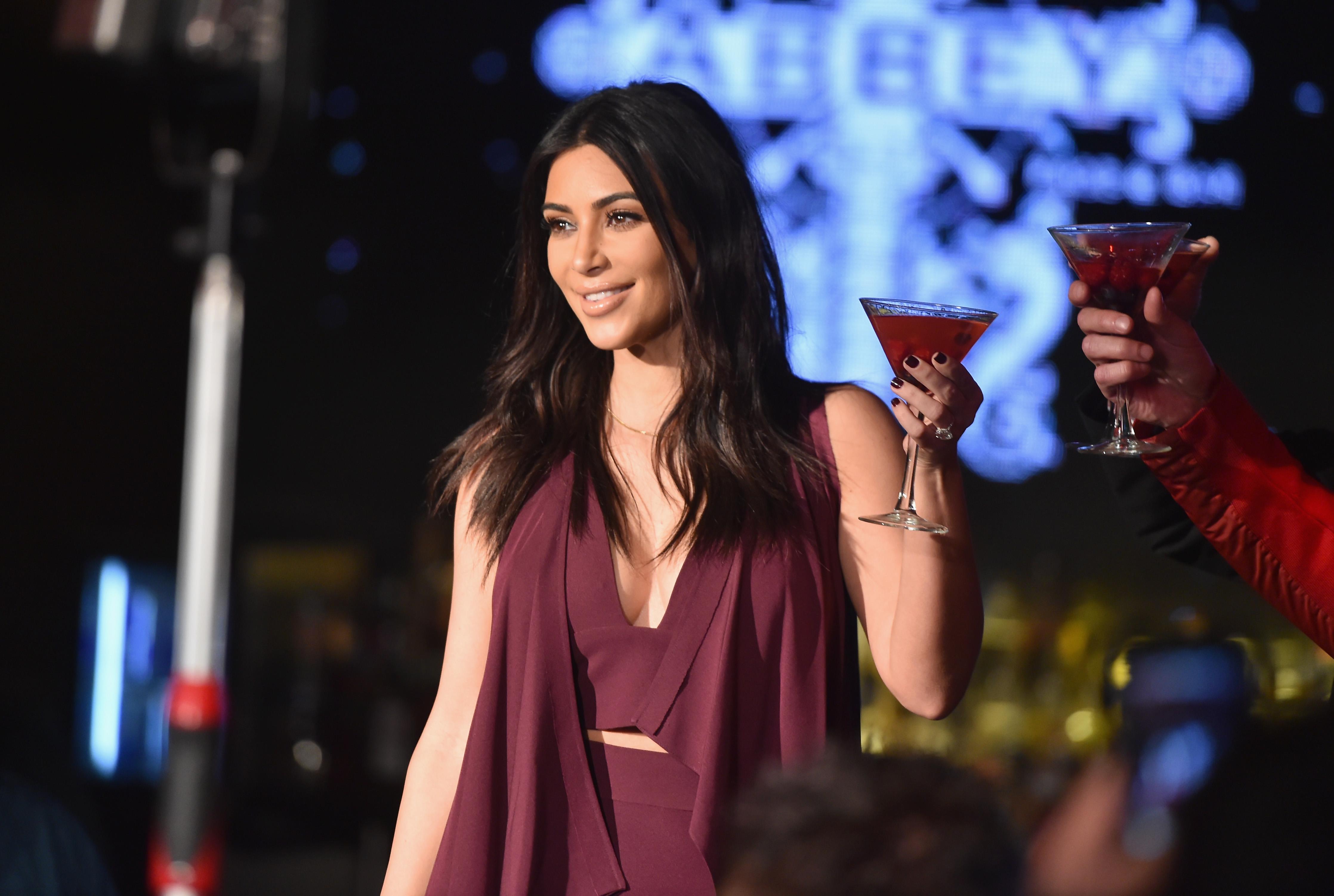 Kim Kardashian Raises Toast For Elizabeth Taylor Foundation/World AIDS Day At The Abbey