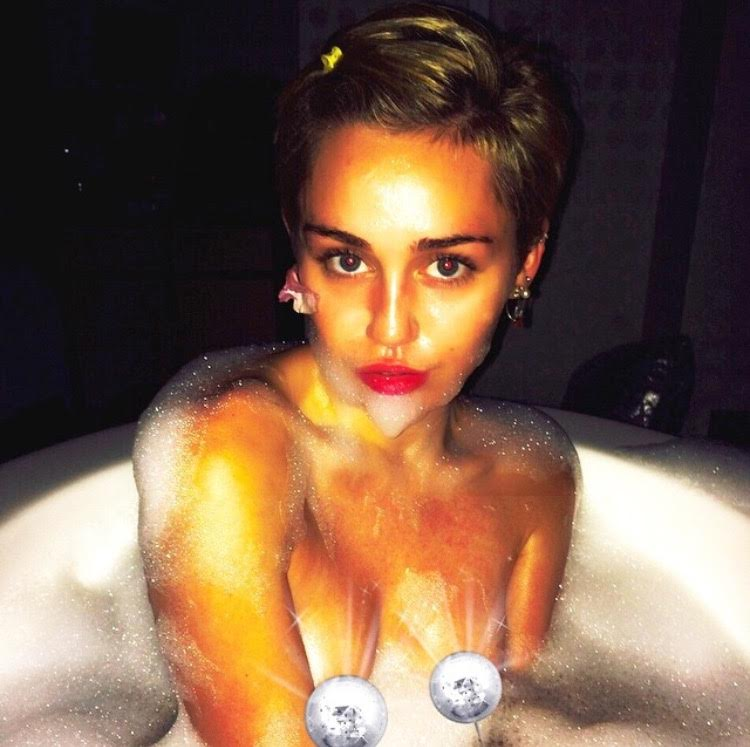 Miley cyrus shares two topless selfies
