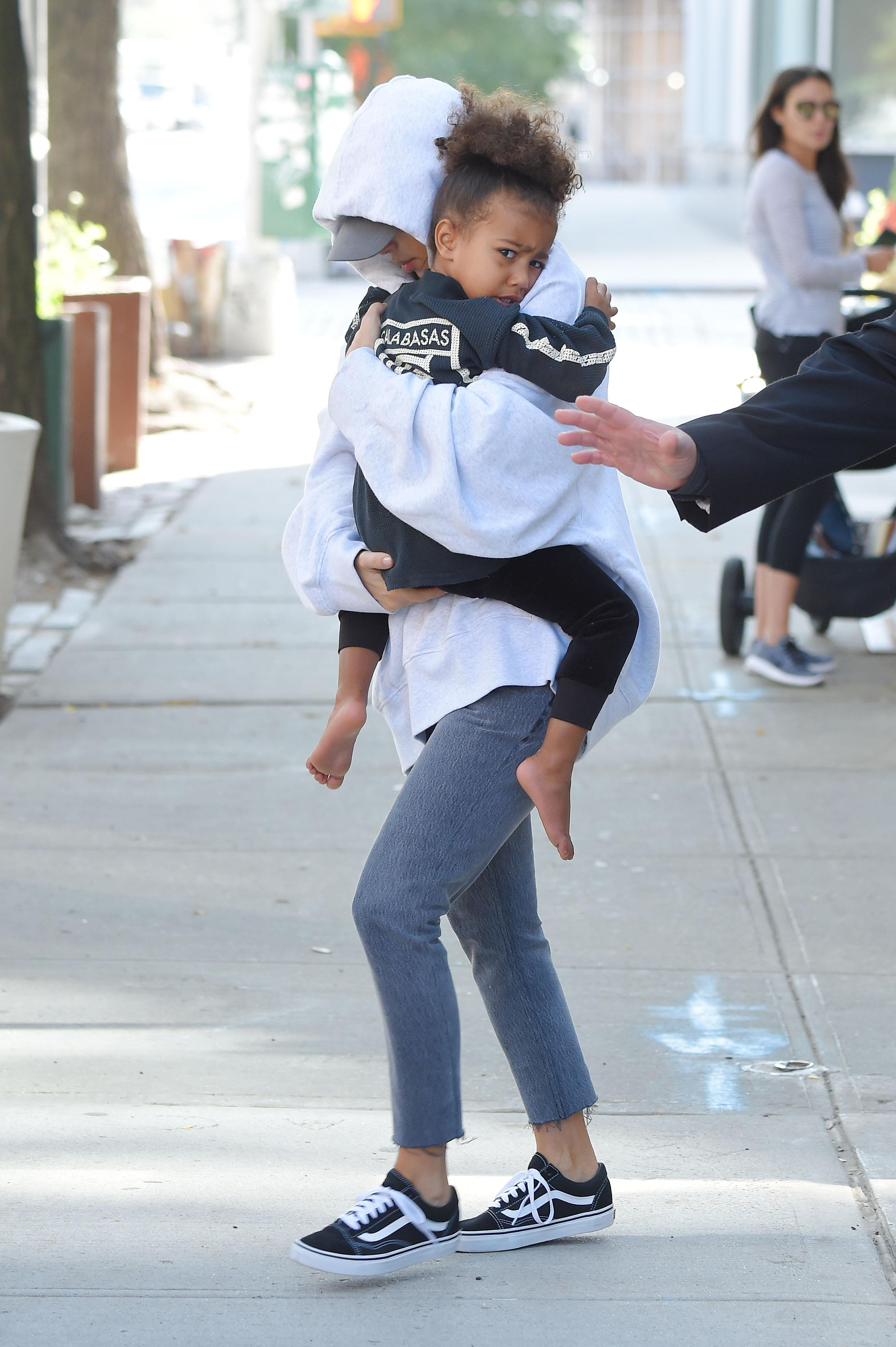 Kim Kardashian and baby North West steps out  of ther AirBnB apartment for the first time after million dollar heist of her jewelry on OCTOBER 06, 2016 in New York City, New York