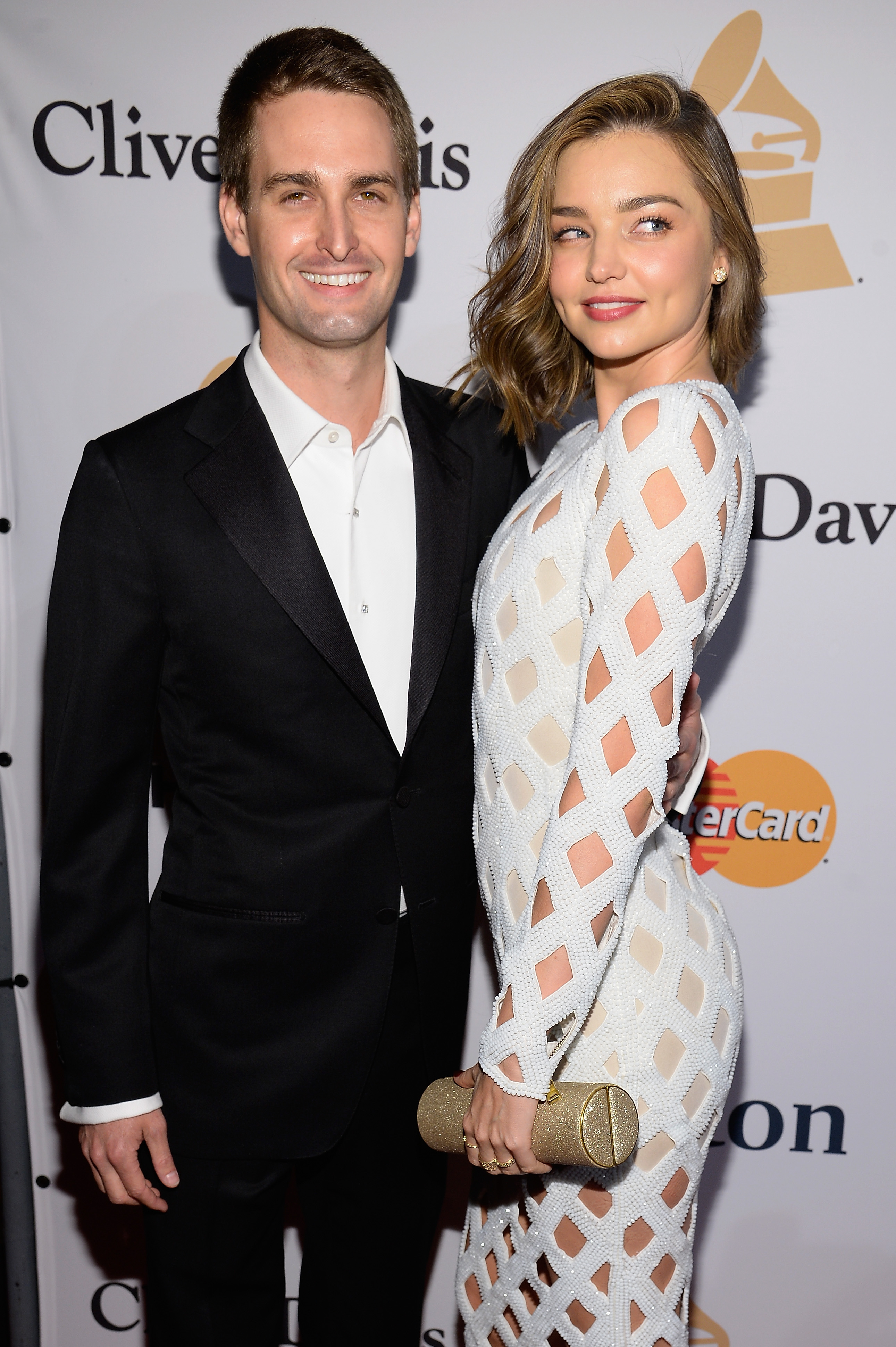 BEVERLY HILLS, CA - FEBRUARY 14:  Co-founder and CEO of Snapchat Evan Spiegel (L) and model Miranda Kerr attend the 2016 Pre-GRAMMY Gala and Salute to Industry Icons honoring Irving Azoff at The Beverly Hilton Hotel on February 14, 2016 in Beverly Hills, California.  (Photo by Kevork Djansezian/Getty Images)