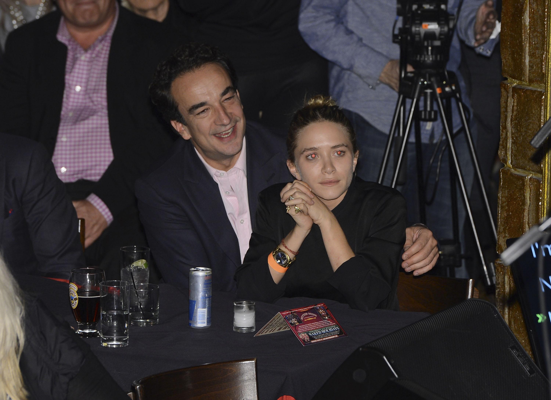 Олсен и Саркози