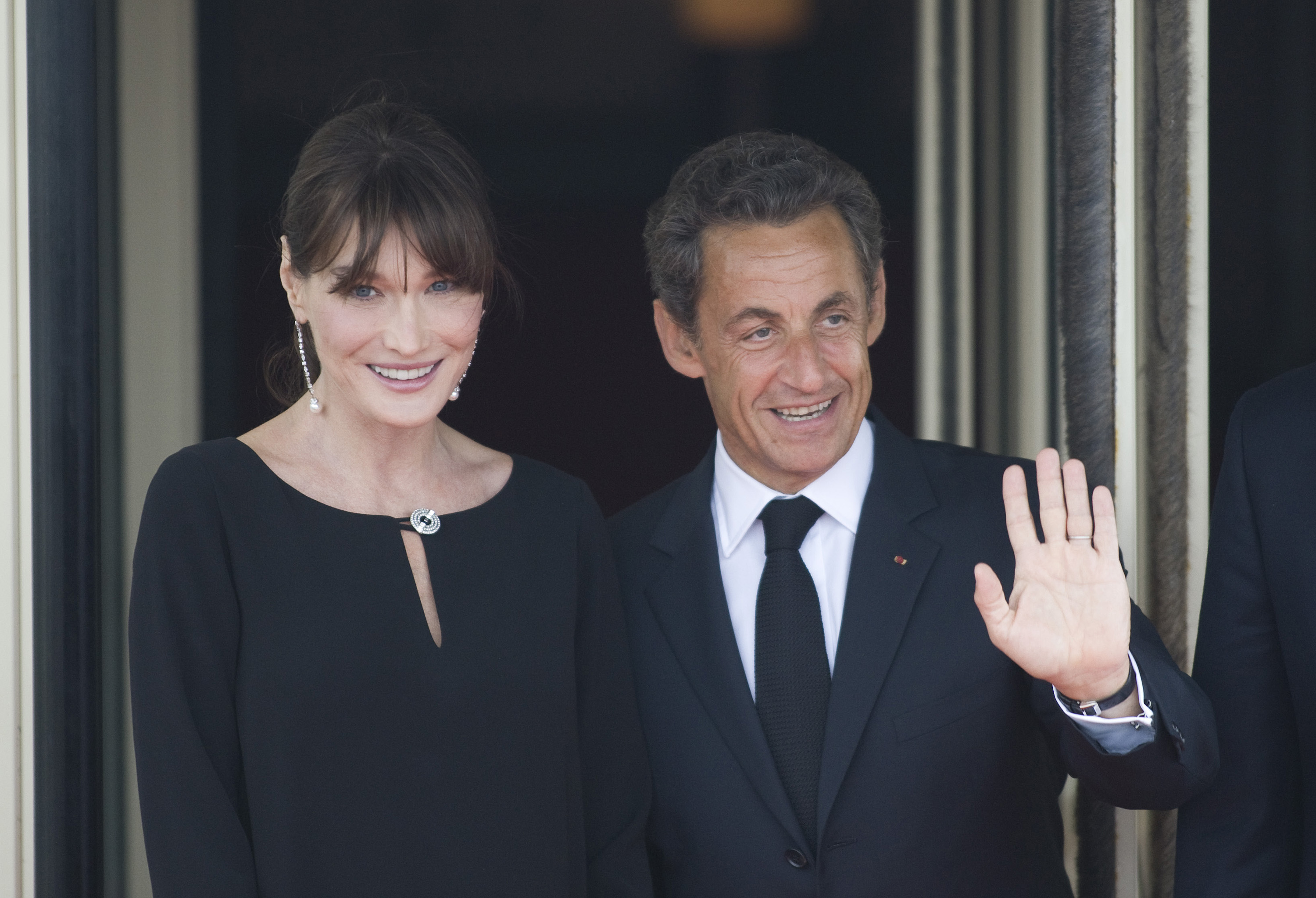 DEAUVILLE, FRANCE - MAY 26:  French President Nicolas Sarkozy and his pregnant wife Carla Bruni-Sarkozy await the arrival of G8 member state leaders and their spouses for an evening dinner function at Le Ciro's Restaurant at the G8 Summit on May 26, 2011 in Deauville, France.  Heads of the world's wealthiest nations are meeting in Deauville, France, for the G8 summit to discuss various security, aid and trade issues, including the 'Arab Spring', nuclear safety and climate change. (Photo by Chris Ratcliffe - Pool/Getty Images)