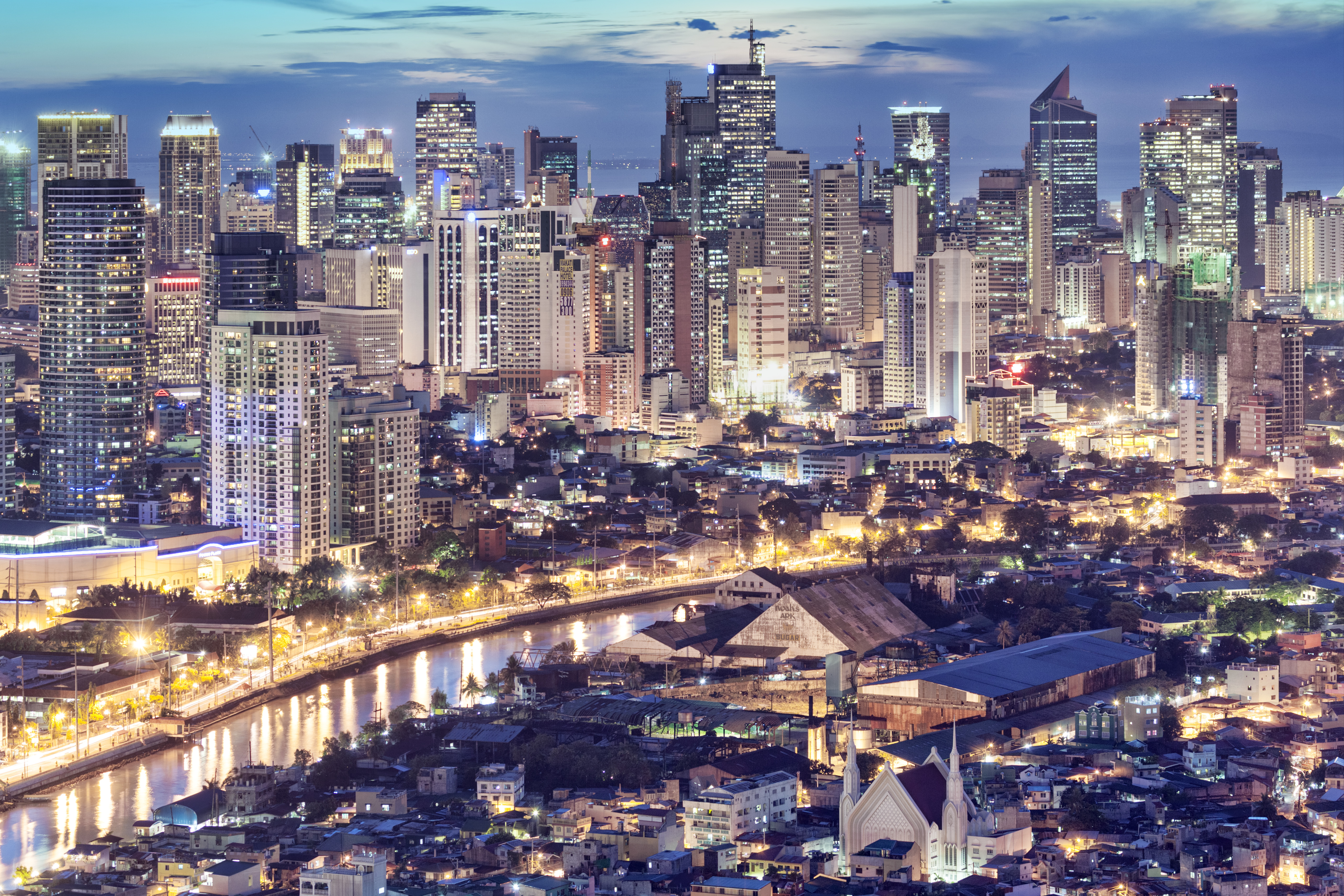 Philippines, Manila, Intramuros, Makati business district and Pasig river at dusk