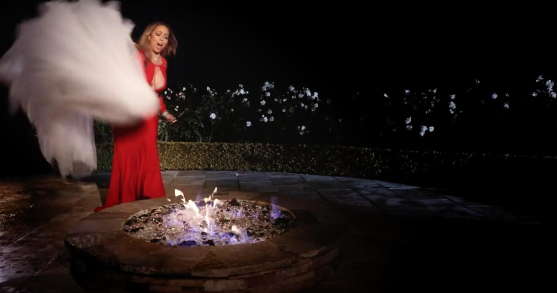 Мэрайя сжигает платье в клипе