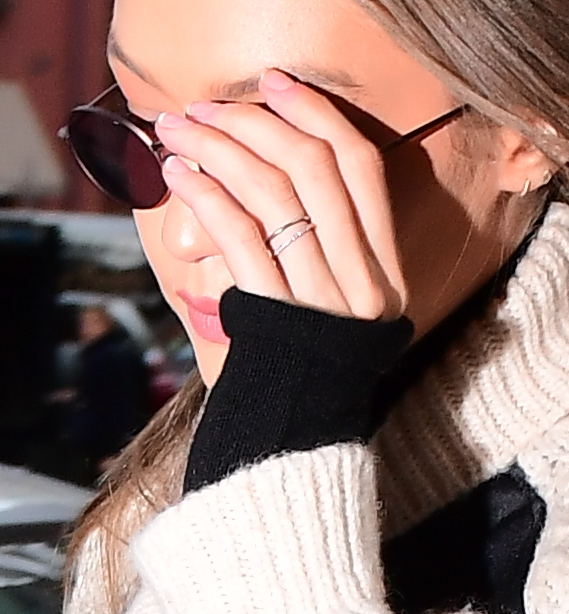 """Gigi Hadid Ditches her """"Engagement Ring"""" opting for 2 smaller Rings as she Returns home from Tommy Hilfiger Offices"""