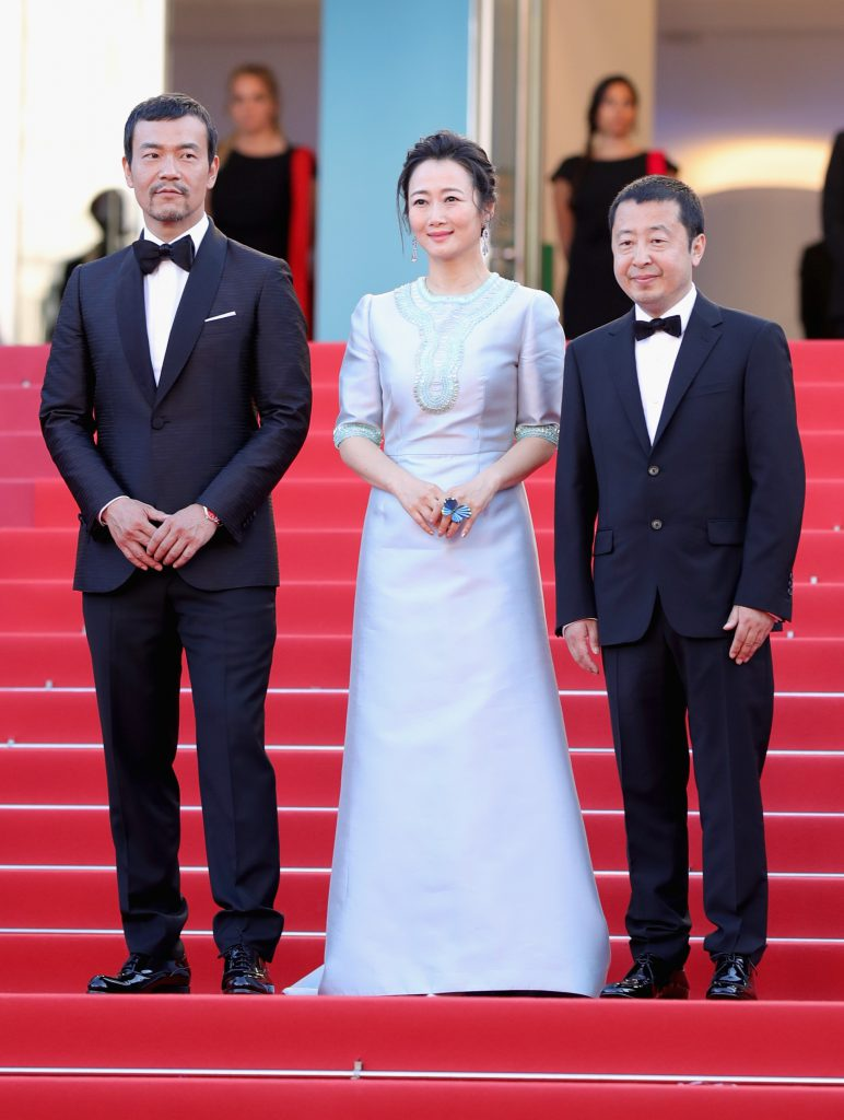 CANNES, FRANCE - MAY 11:  (L-R) Actor Fan Liao, actress Tao Zhao and director Zhangke Jia attend the screening of