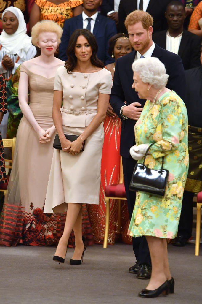 Принц Гарри, королева Елизавета и Меган Маркл